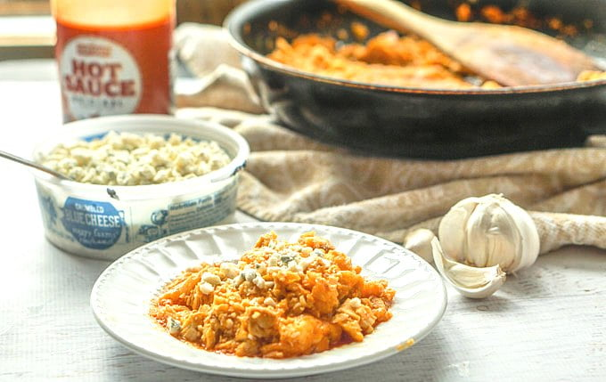 This low carb buffalo cauliflower rice with chicken dish is a very easy and delicious one pot dinner that you can make in just 15 minutes. This is the perfect quick and easy low carb dinner or lunch and each serving has only 3.7g net carbs!