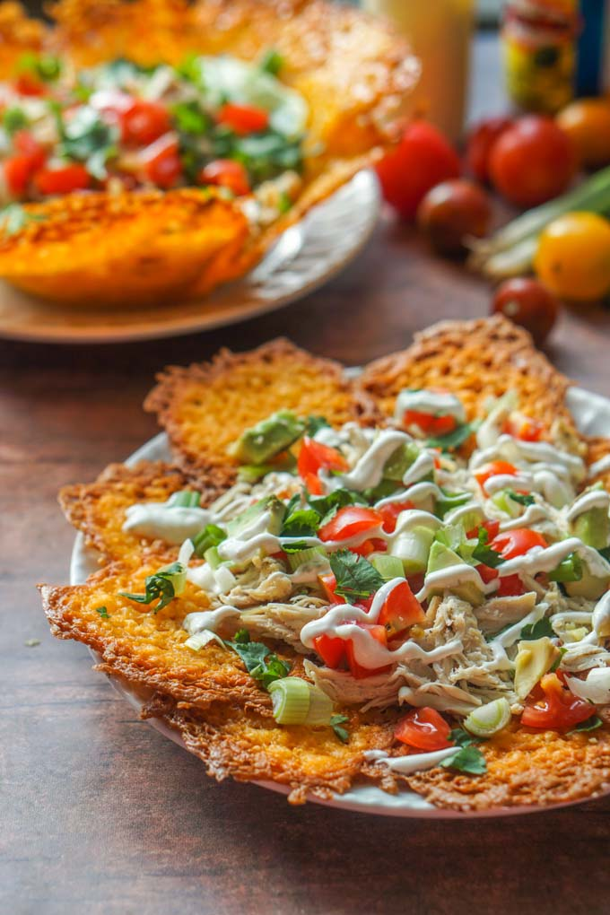 These low carb keto chicken nachos taste great as a taco salad to0! Making chips and taco shells out of cheese is the perfect vehicle for making Mexican dishes such as these. Either as nachos or a taco salad there is only 2.6g net carbs!