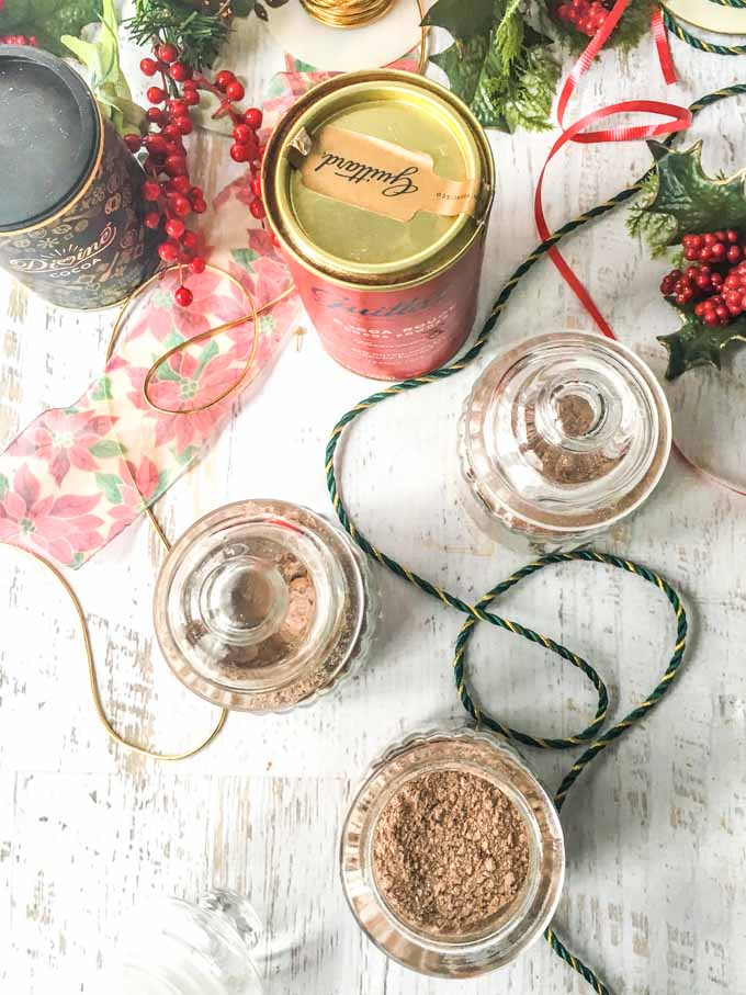 aerial view of glass jars with sugar free cocoa mix and fancy cocoa powders and ribbons