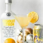 keto lemon drop martini with a Meyer lemon, Absolut vodka, seltzer and ornaments and text