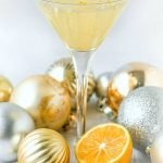 keto lemon drop martini with a Meyer lemon and ornaments and text