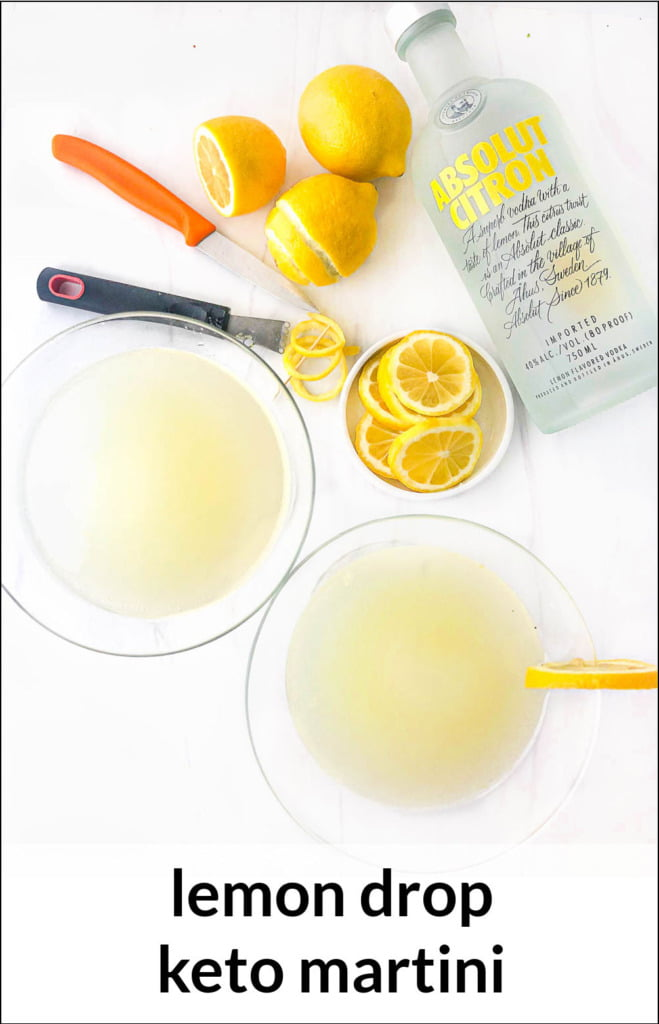 two lemon drop martinis with Absolut vodka bottle and lemons with text