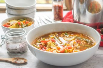 This low calorie and low carb vegetable soup is my super tasty version of that cabbage soup everyone makes. It's full of flavor and healthy vegetables and easy to freeze. Each serving has only 70 calories and 5.1g net carbs.