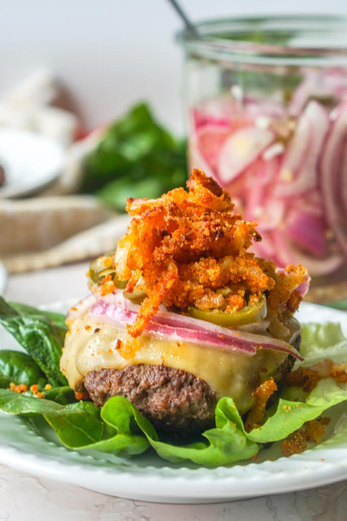 These keto butter burgers are so tasty as is but topped with low carb onion straws and pickled jalapeños they go to another level.