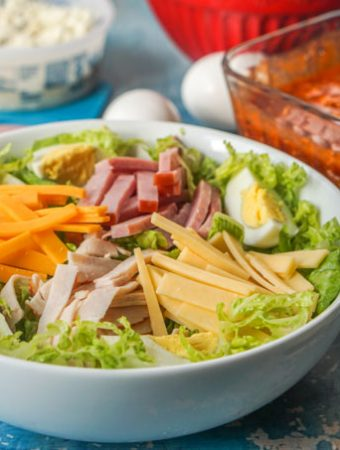 This low carb chef salad is a hearty salad you can eat for dinner and feel very satisfied. I topped mine with a low carb red roquefort dressing that was sweet, tangy and full of blue cheese. Only 3.0g net carbs for the whole salad.