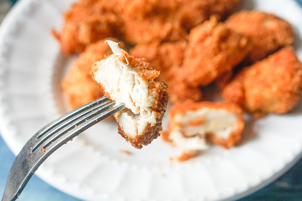 a fork with a bite of keto chicken nuggets