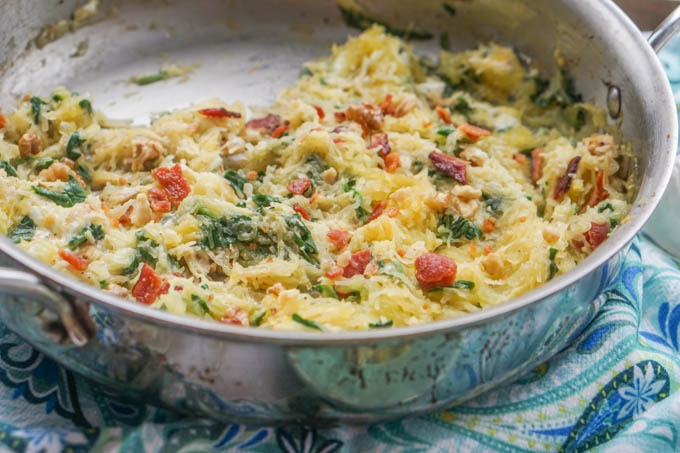 This tasty low carb spaghetti squash pasta is so easy you can make it in 5 minutes with already cooked ingredients or 20 if you don't. Tangy goat cheese, crunchy walnuts and crispy bacon add lost of flavor to this gluten free pasta dish!