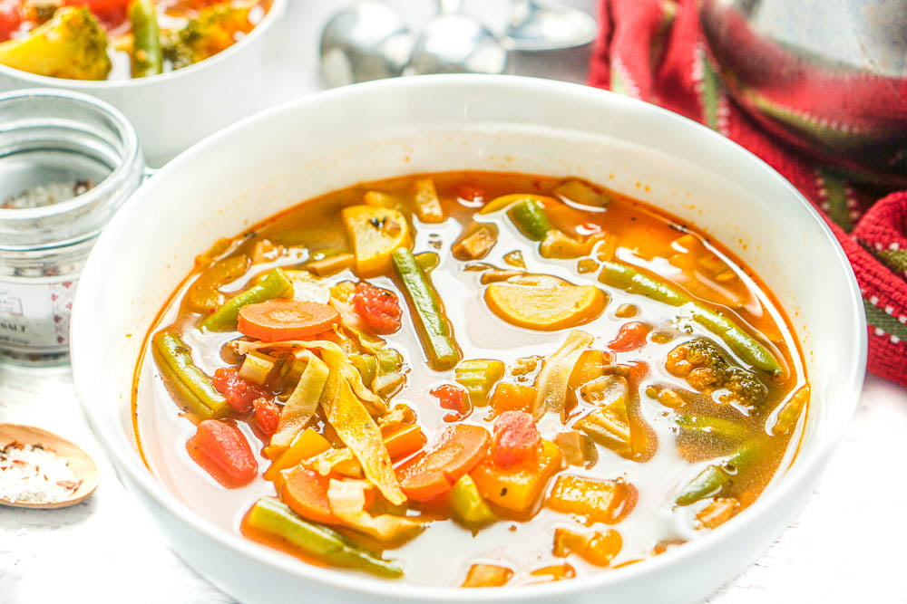 closeup of low calorie soup in white bowl