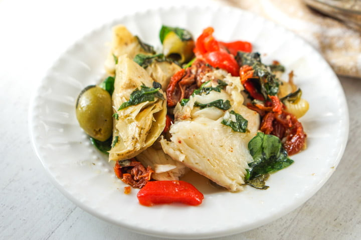 white plate with low carb Mediterranean fish dinner
