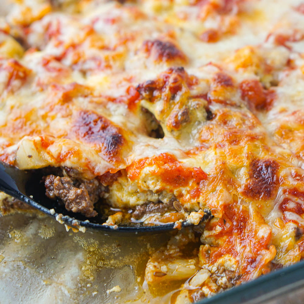 closeup of keto ground beef casserole and black spoon