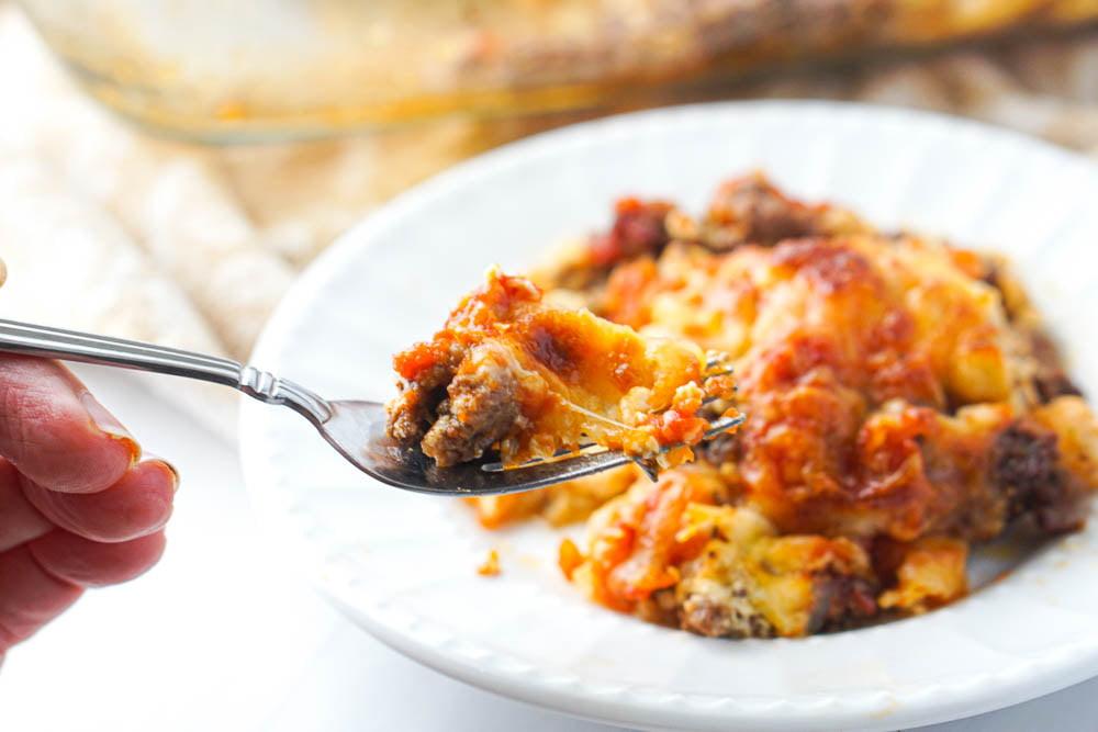 a forkful of hamburger & cauliflower keto casserole