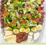 Long photo of salad and cheese platter with text overlay.