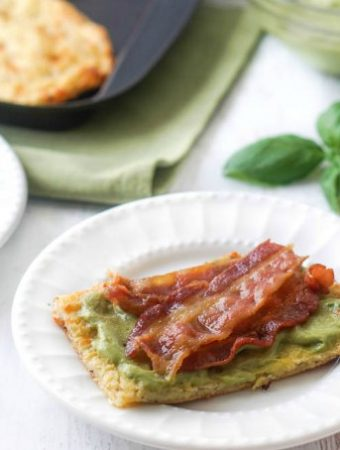 low carb bacon sandwich with avocado spread and fresh basil