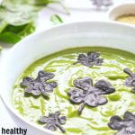Long photo of green smoothie bowl with chocolate shamrocks and text overlay.