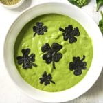 Photo of white bowl full of green smoothie and chocolate shamrocks.