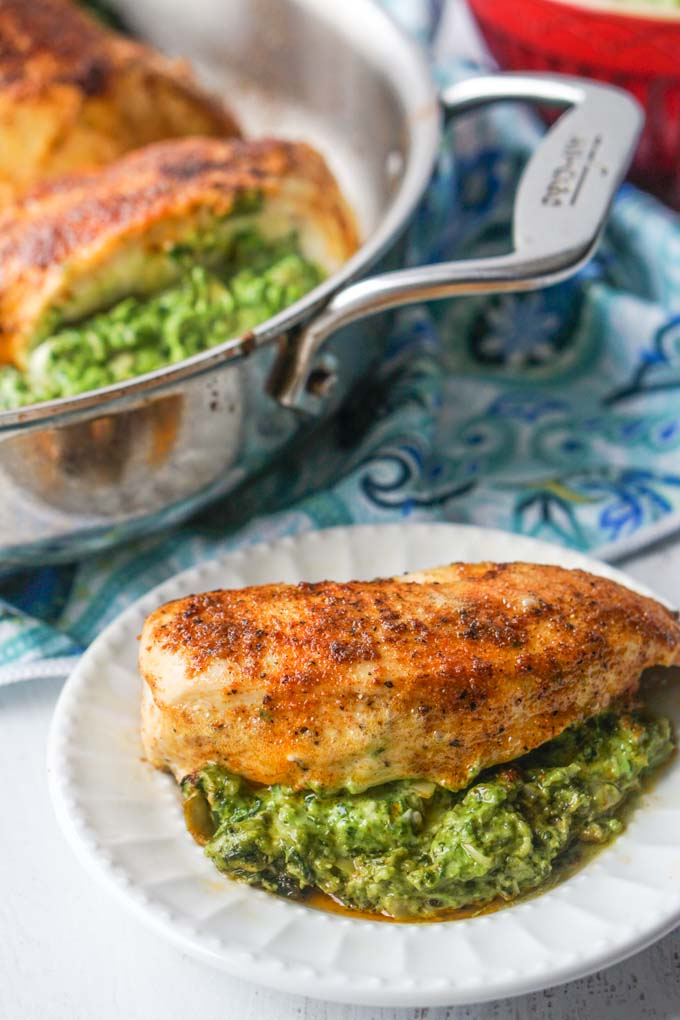long photo of stuffed chicken breast with pan in the background