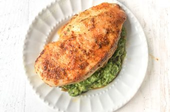 White plate with stuffed chicken breast.
