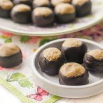 White plate with low carb buckeyes on it and floral napkin