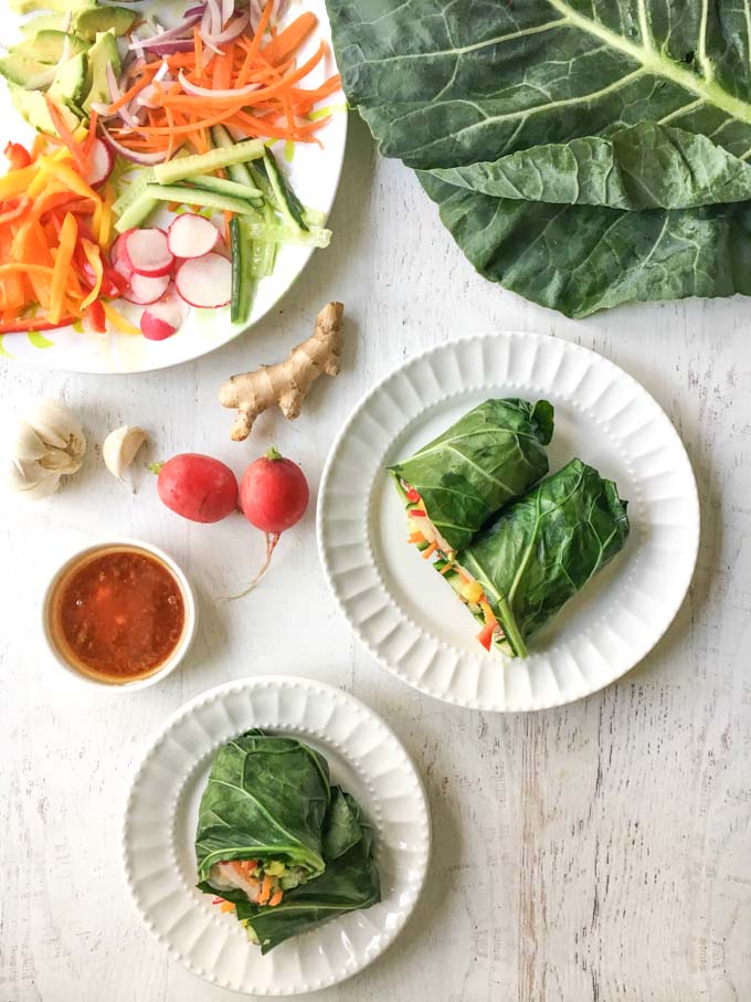 aerial photo of collard greens leaf wrap spring roll  with radishes in background