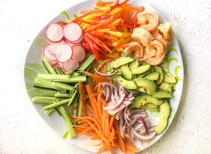 Plate of spring roll vegetables cut up and shrimp