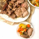 white platter and plate with Instant Pot Leg of Lamb with text