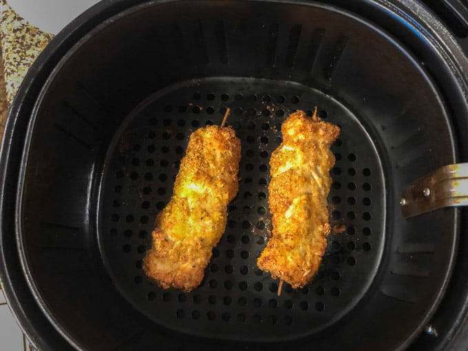 two low carb city chicken in an air fryer basket