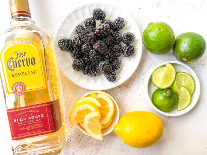 tequila, blackberries, limes, and lemons to make tequila infusion