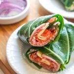 white plate with collard greens sub sandwich wrap