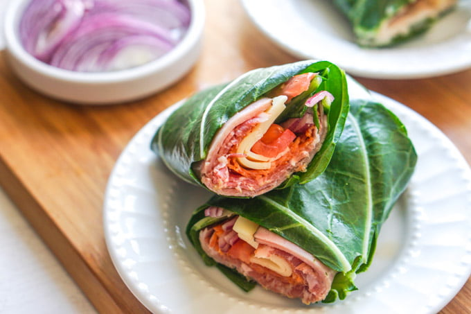 collard green low carb sub sandwich wrap on white plate