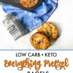 keto everything pretzel bagels in baking tin on a blue towel and cream cheese in background and a bite taken out with text overlay