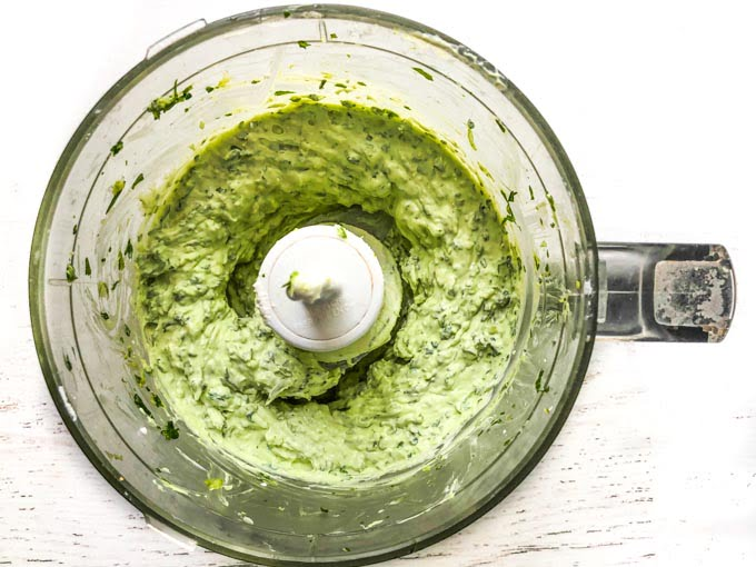 bowl of food processor with low carb creamy herb sauce