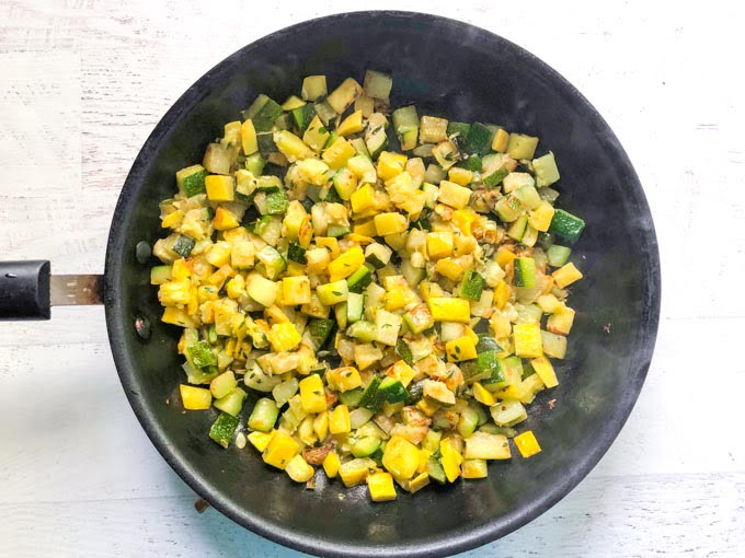 pan of cooked yellow and green diced zucchini