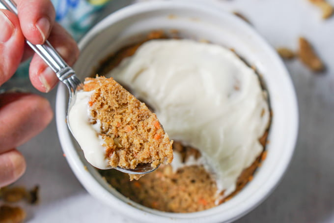 a spoonful of carrot cake with cream cheese frosting