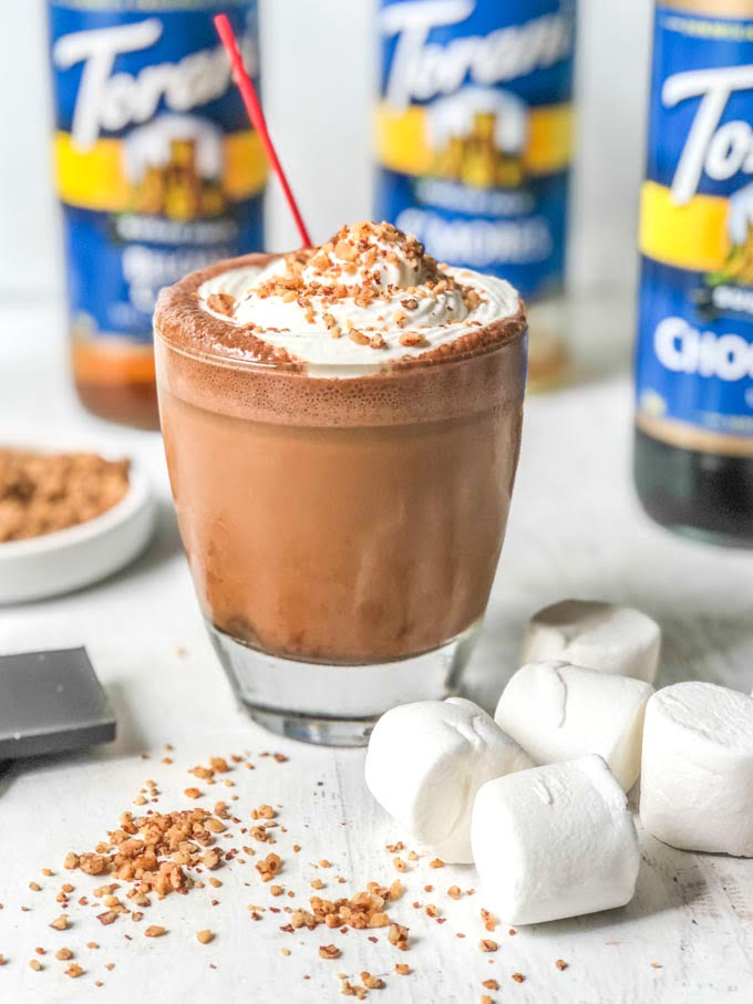 ice coffee drink with marshmallows and torani syrup bottle in the background