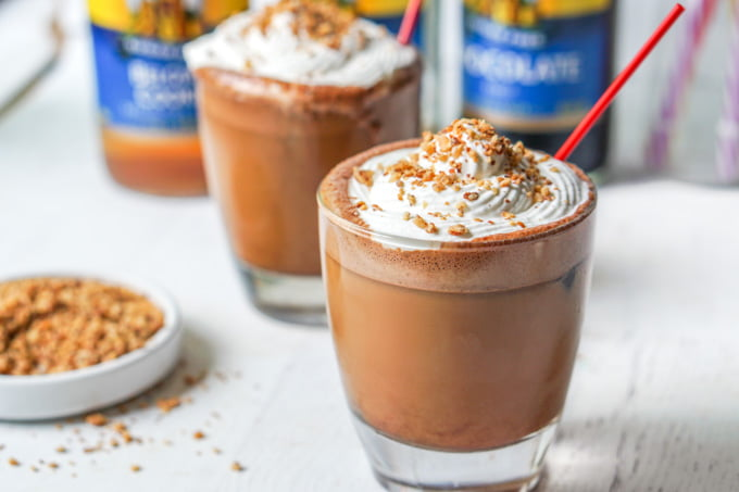s'mores bulletproof coffee drink with whipped cream and a red sraw