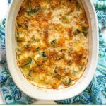 baking dish with low carb zucchini au gratin and text overlay