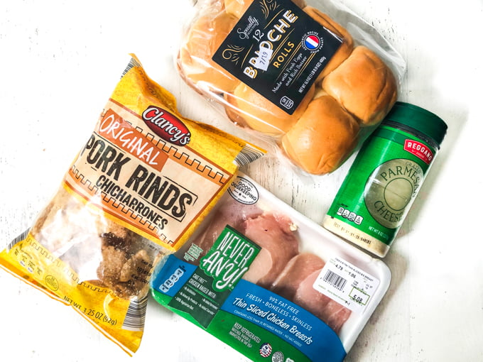 pork rinds bag, brioche buns, parmesan cheese and package of chicken breast
