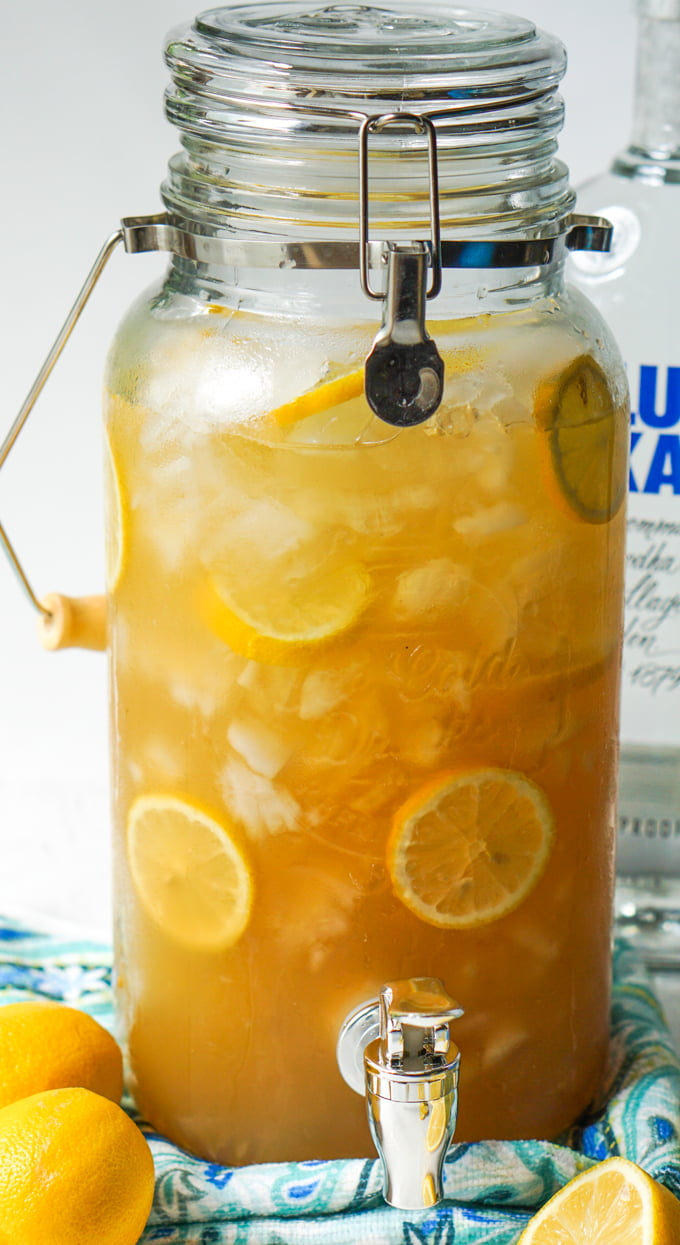 large drink dispense with spiked iced tea keto tailgate drinks and slices of lemons