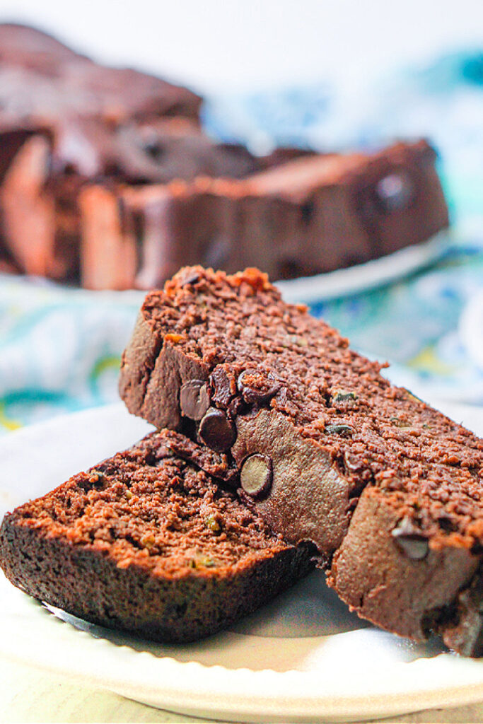 closeup of 2 pieces of chocolate zucchini blender bread on a white plate