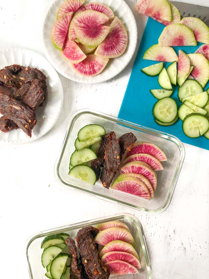 keto snack boxes with jerky, cucumber and radish slices
