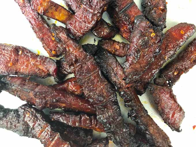 closeup up of strips of low carb smoked beef jerky