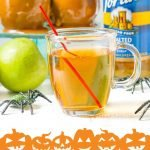 low carb caramel apple drinks in Halloween glasses with turquoise scarf and apples in background and text overlay