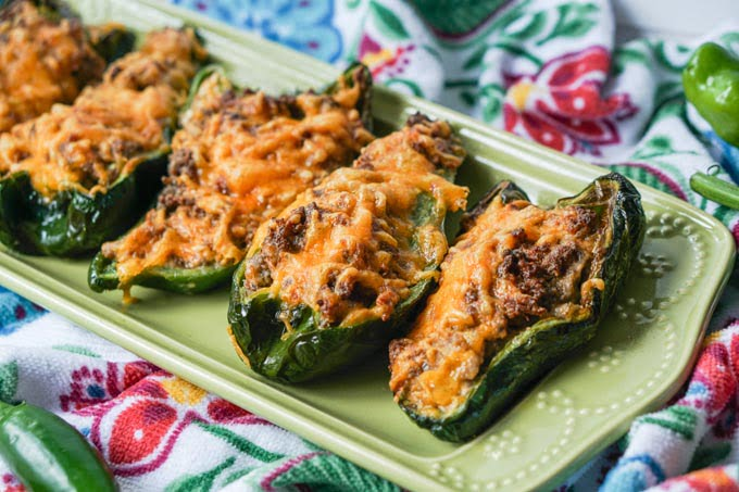sausage & cheese stuffed poblano on green platter