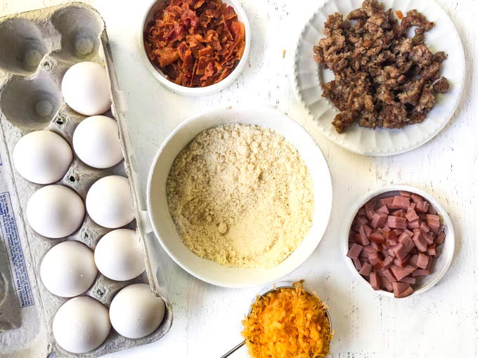 biscuit ingredients of eggs, almond flour, bacon, sausage, ham and cheese