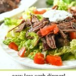 closeup of salad with slow cooker tender lamb roast on top and text overlay