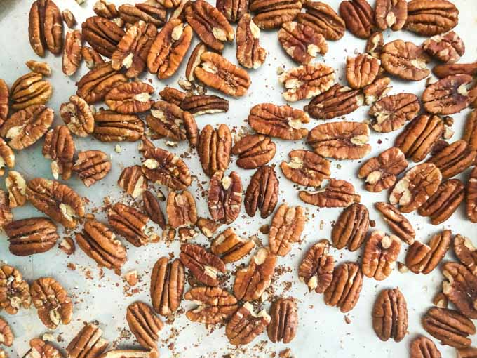 raw whole pecans on cookie sheet
