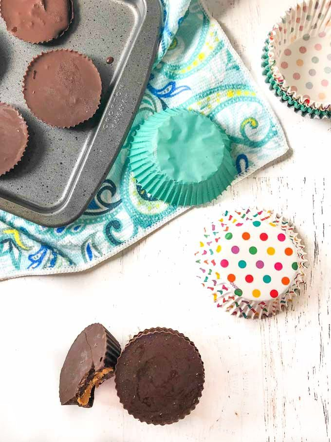 sugar free peanut butter cups with cupcake liners and cookie tray and paisley tea towel