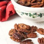 bowl of keto candied pecans with text overlay