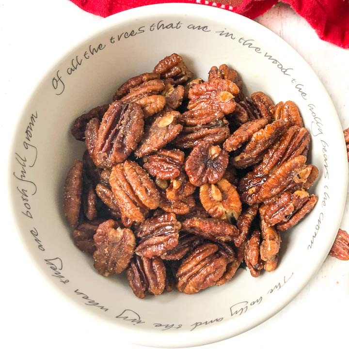 decorative white bowl with keto candied pecans