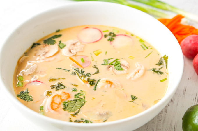 large white bowl of shrimp curry soup